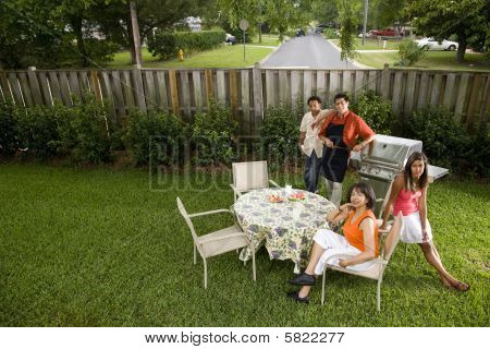 Family relaxing in backyard