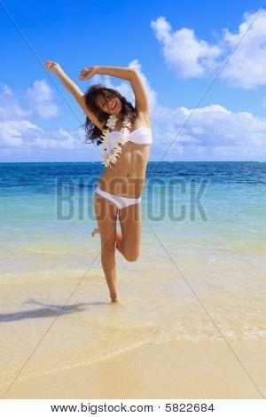 young woman in a white bikini