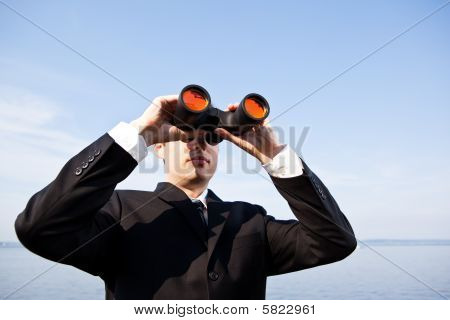 Caucasian Businessman With Binoculars