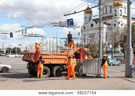 MOSCOW, RUSSIA, CIRCA 2012 - Street workers demount steel constructions circa 2012 in Moscow, Russia