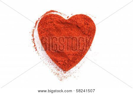 Pile Of Ground Paprika Isolated In Heart Shape On White Background.