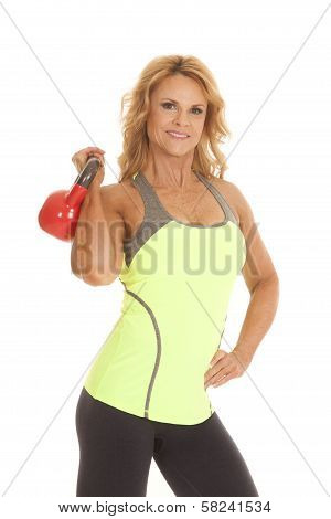 Mature Woman Green Tank Red Kettle Bell Over Shoulder