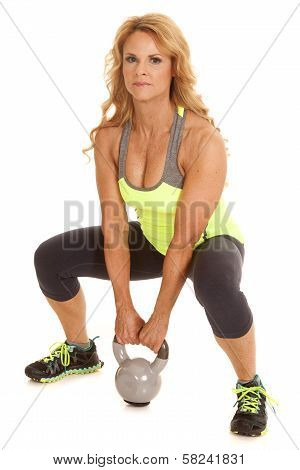 Mature Woman Green With Kettle Bell Squat