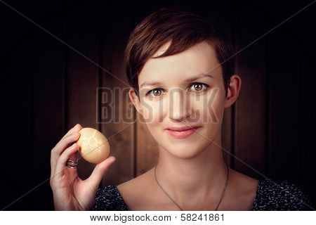 Pretty Young Brunette Woman Holding Hatching Egg