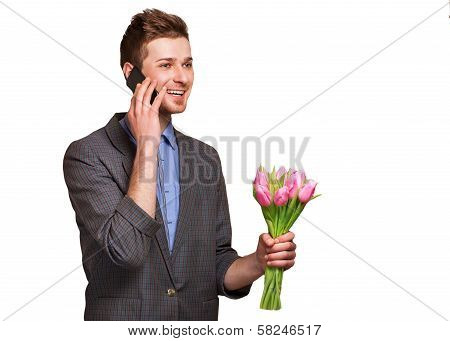 A Young Romantic Man Holding A Bouquet Of Flowers Isolated On White Background