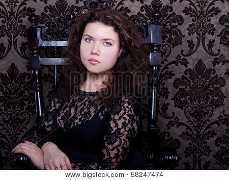 Sad Woman Sit In The Wood Chair