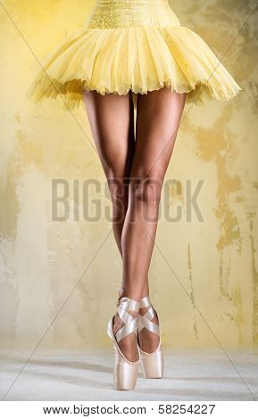 Ballerina On Point OBallerina on point in yellow tutu over obsolete wallver Obsolete Wall