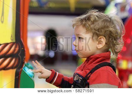 Kid Playing On Game Machine