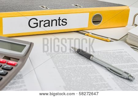 A yellow folder with the label Grants