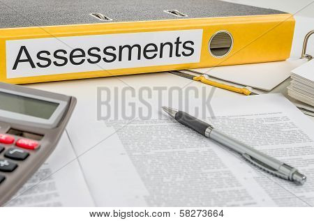 A yellow folder with the label Assessments