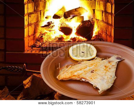 Fried Sole Fish On Plate And Open Fire In Oven