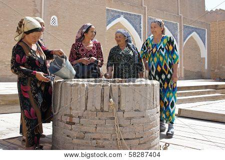 Old women around a well, Khiva, Uzbekistan