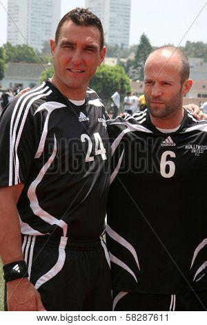 Vinnie Jones and Jason Statham at the Soccer for Survivors Celebrity Showcase Match. Beverly Hills High School, Beverly Hills, CA. 07-22-07