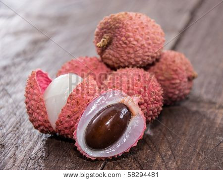 Fresh Lychees On Wooden Background