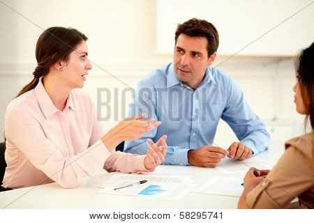 Female Executive Explaining A Idea To Colleagues