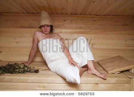 Young Woman Is Sitting At Sauna Bath