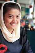 stock photo of arabic woman  - portrait of muslim woman smiling wearing veil - JPG