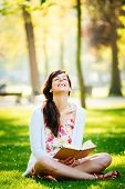 Woman Reading Book And Having Fun In Park