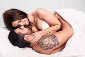 picture of flirt  - Love couple flirting and hugging in bed - JPG