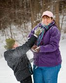 picture of snowball-fight  - Mother and son playing in snow by having snowball fight - JPG