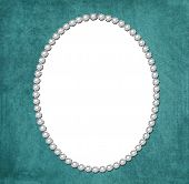 foto of oval  - An oval shaped pearl frame on a blue textured background - JPG