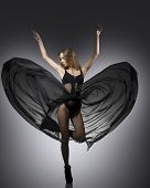 stock photo of flutter  - creative fashion portrait of sexy girl with transparent dark dress and fluttering light veil skirt - JPG