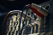 foto of mixer  - audio cable coming into analogue sound mixer in recording studio indoor blurred shot with particular focus on center - JPG