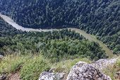 picture of pieniny  - spectacular river canyon in Pieniny Poland viewed from Sokolica peakwith vertical rocks and river and forest down below - JPG