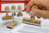 stock photo of priorities  - guidelines marked on rubber stamp in hand - JPG