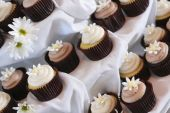 pic of cupcakes  - Closeup of cupcakes with flowers at fancy party - JPG