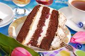 image of tort  - piece of chocolate and cherry torte with meringues and cup of coffee - JPG