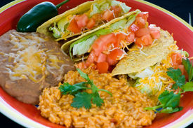 foto of mexican food  - A colorful Mexican food plate with tacos bean and rice - JPG