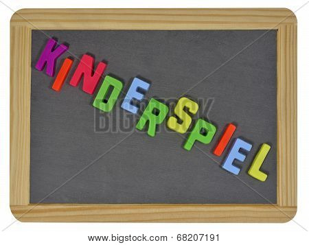 Kinderspiel written on traditional school slate