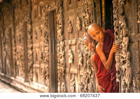 Two Young Monks Standing At Shwenandaw Monastery In Mandalay,Myanmar.