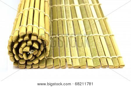 Rolled Straw Mat Over White Background, Top View