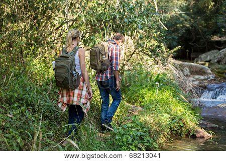 two hikers walking in mountain