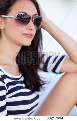 Beautiful young woman posing with sunglasses