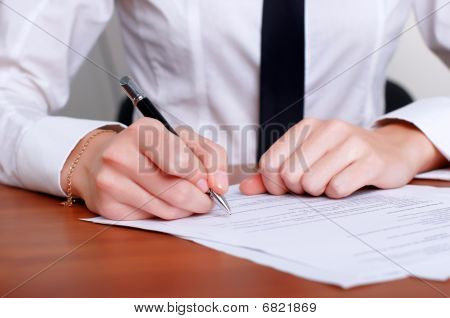 Person's Hand Signing Document