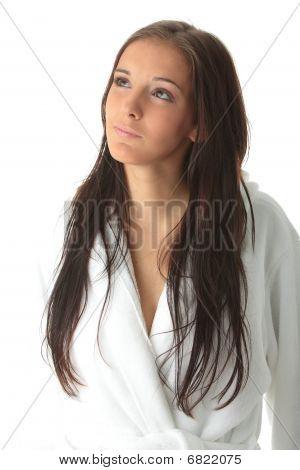 Young Caucasian Woman In Bathrobe