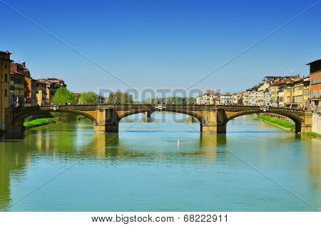 FLORENCE, ITALY - APRIL 15: Ponte Santa Trinita bridge and Arno River on April 15, 2013 in Florence, Italy. This Renaissance bridge is the oldest elliptic arch bridge in the world