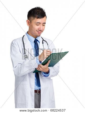 Asian male doctor write on clipboard