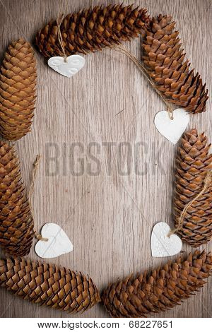Heart Shaped Christmas Decorations And Spuce Cones Frame.