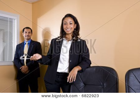 Multi-ethnic businessman and businesswoman in office boardroom
