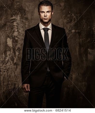 Handsome young well-dressed man in jacket