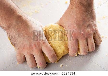 man hands kneading dough