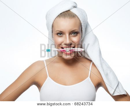 closeup teeth portrait of attractive  caucasian smiling woman isolated on white studio shot lips toothy smile face head and shoulders looking at camera blue eyes tooth brush