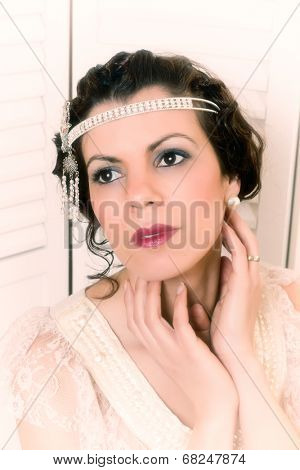 closeup of a beautiful vintage 1920 lady with flapper dress and headband