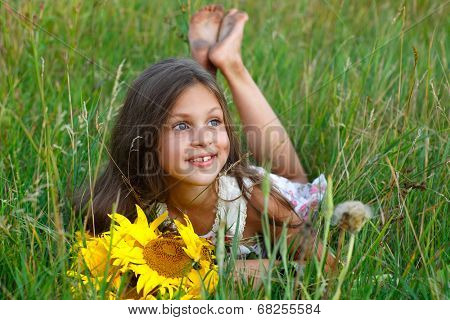 little glad girl with yellow on green a meadow, emotions, lifestyle