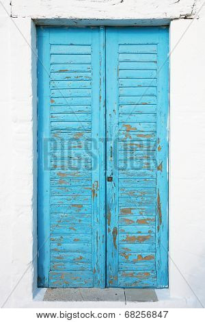 Old blue textured door with cracks