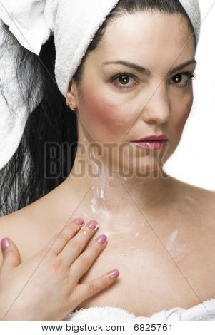 Woman Applying Cream On Body